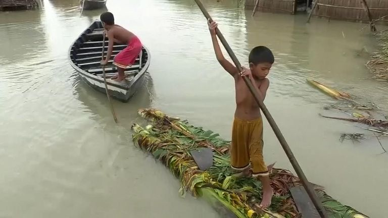 A child using a raft to escape flooding in Bangladesh