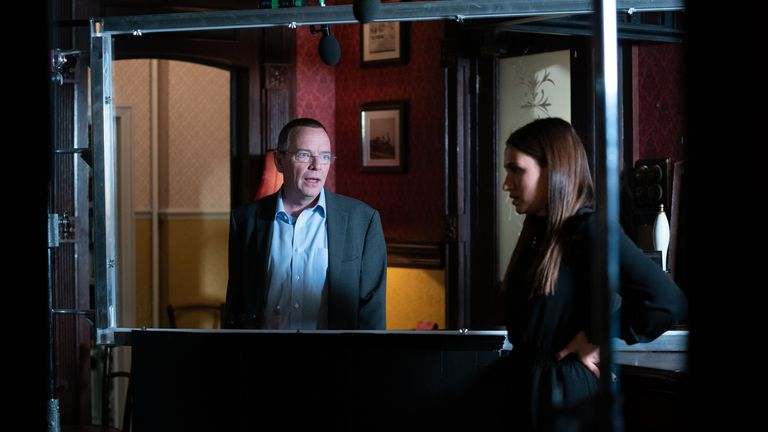 Adam Woodyatt (left) who plays Ian Beale, and Milly Zero (right), who plays Dotty Cotton, are seen using a perspex screen