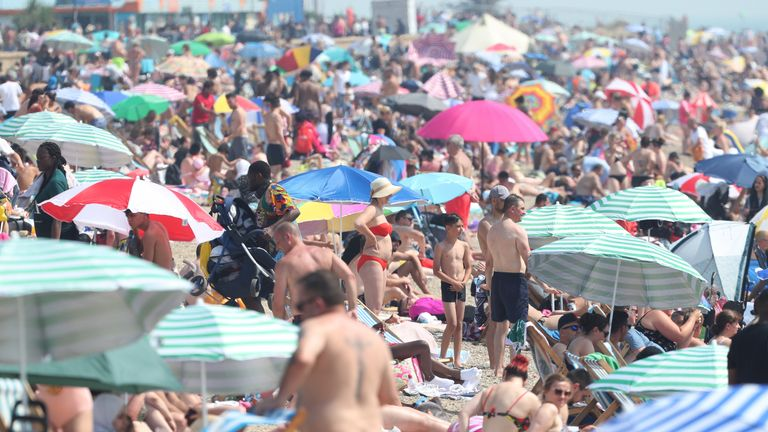 People enjoying the hot weather at Southend beach in Essex
