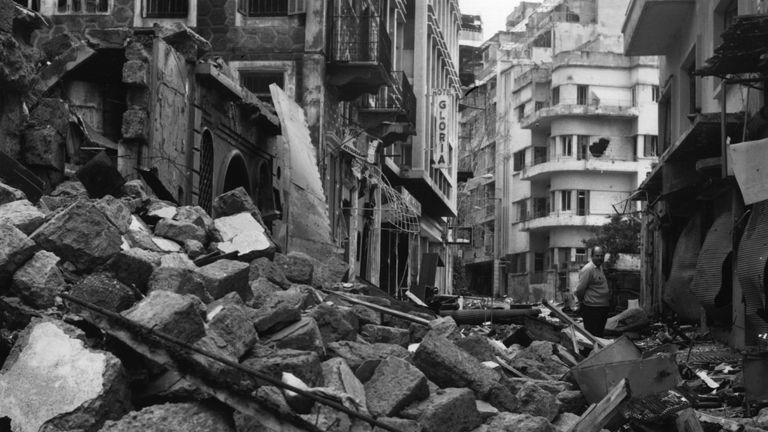 One of Beirut's narrow streets piled high with rubble during the civil war in 1975