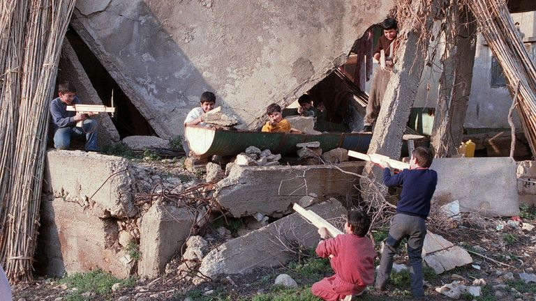 Lebanese children play on the Port-Normandy green line between East and West Beirut in January 1989
