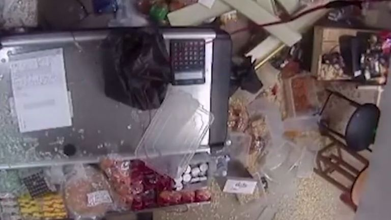 Supermarket windows are blown out and shelves knocked over by aftershock of Beirut blast