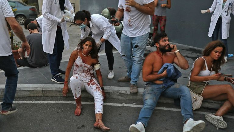 The wounded are treated in the street outside a hospital