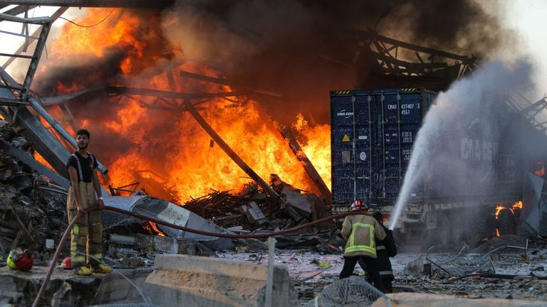 Firefighters douse the blaze at the scene of the explosion in Beirut