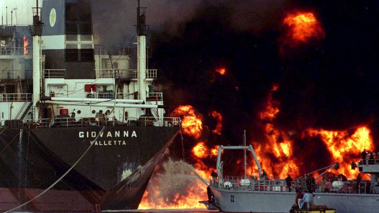 A Lebanese naval fireboat battles a blaze on a Maltese-flagged fuel tanker at Beirut's port in 1998