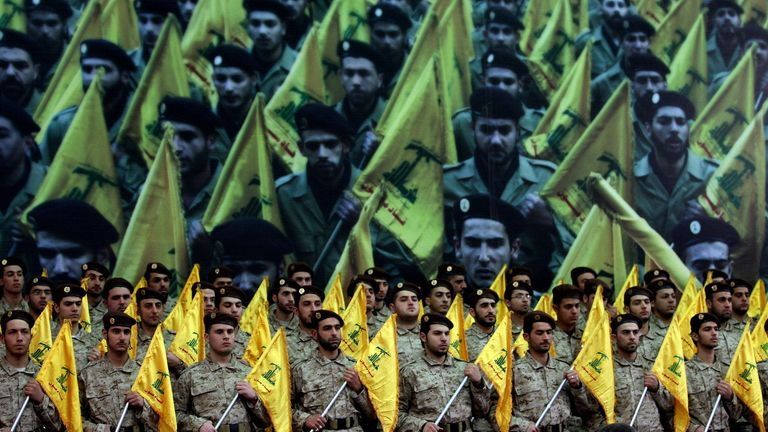 Shiite Muslims Hezbollah militants stand to attention in 2008