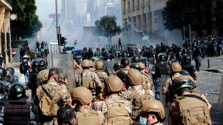 Lebanese demonstrators throw tear gas canisters back at security forces