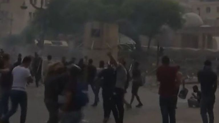Protesters throw objects on streets of Beirut