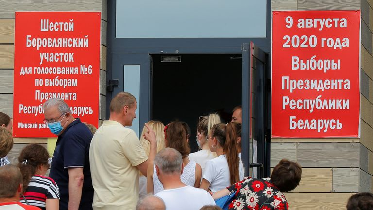 People queue outside a polling station to cast their votes in the presidential election in Belarus