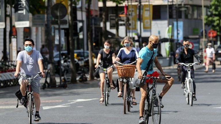 Cyclists wear face masks in Antwerp after lockdown measures were tightened