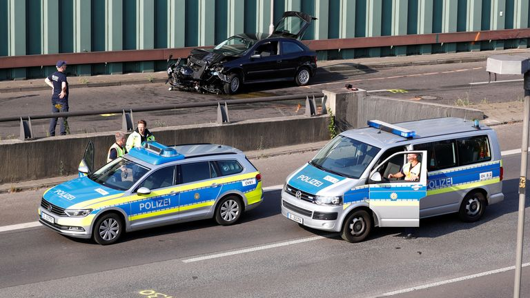 Police officers investigate the scene of a series of allegedly deliberate car crashes on highway A100 in Berlin, Germany, August 19, 2020. REUTERS/Fabrizio Bensch