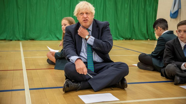 Britain's Prime Minister Boris Johnson visits Castle Rock school as he takes part in a getting to know you induction session on the pupil's first day back to school, in Coalville, Britain August 26, 2020. Jack Hill/Pool via REUTERS