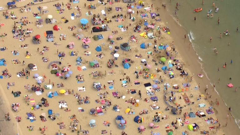 A birds-eye view of people enjoying a day out at the beach in Bournemouth