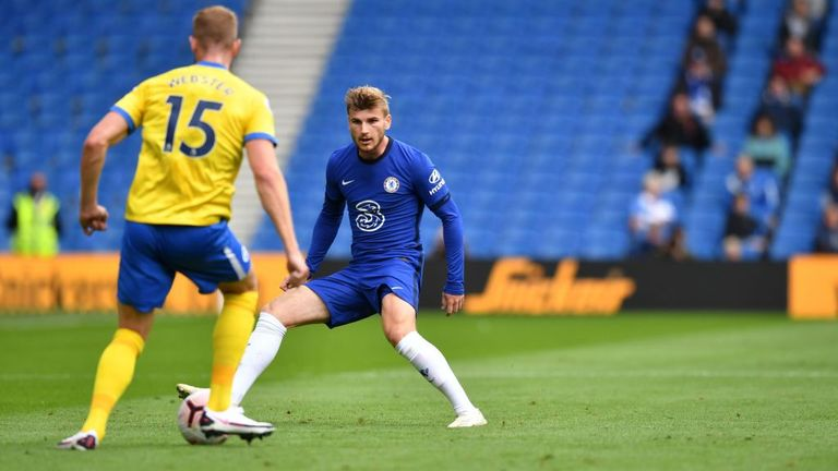 Brighton's English defender Adam Webster (L) vies with Chelsea's German striker Timo Werner (C) as socially distanced fans watch from the stands during the pre-season friendly football match between Brighton and Hove Albion and Chelsea at the American Express Community Stadium in Brighton, southern England on August 29, 2020. - The game is a 'pilot' event where a small number of fans will be present on a socially-distanced basis. The aim is to get fans back into stadiums in the Premier League by