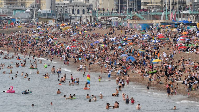 BRIGHTON, UNITED KINGDOM - AUGUST 08: Brighton beach is packed as the South of England basks in a summer heatwave on August 08, 2020 in Brighton, United Kingdom. Parts of England are enjoying a three-day heatwave with temperatures set to reach up to 38 degrees centigrade in the South East. (Photo by Mike Hewitt/Getty Images)