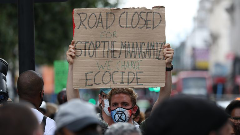 An Extinction Rebellion protester supporting the Stop the Maangamizi Campaign