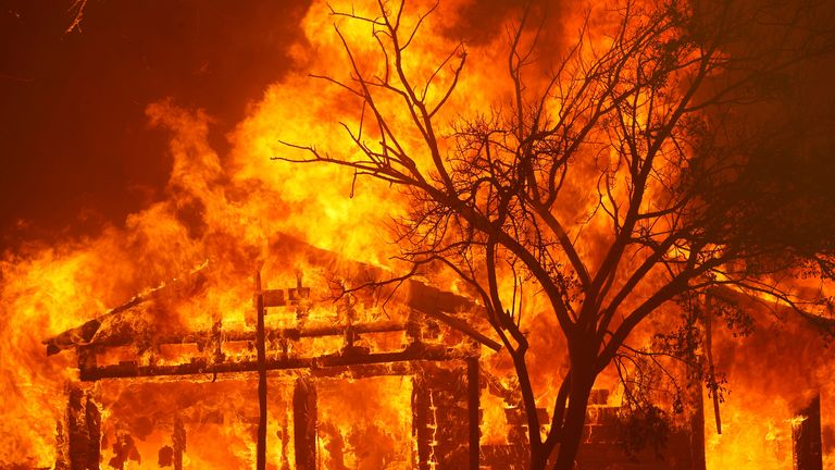 A house burns on the outskirts of Vacaville, California