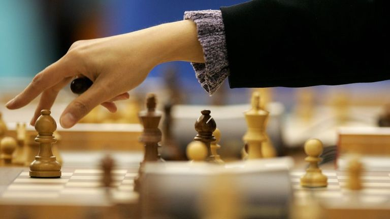 DOHA, QATAR - DECEMBER 04: Olga Sabirova of Uzbekistan makes a move in the Women's Rapid Swiss Chess Round 7 match at the Al Dana Indoor Hall during the 15th Asian Games Doha 2006 on December 4, 2006 in Doha, Qatar. (Photo by Julian Finney/Getty Images for DAGOC)
