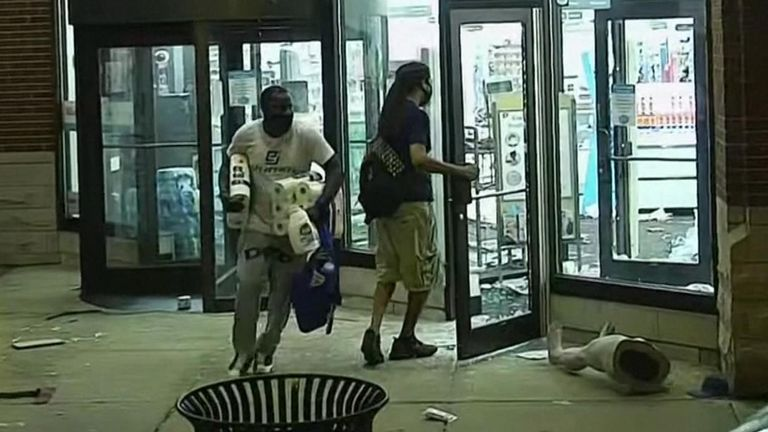 Hundreds of people smashed windows, stole from stores and clashed with police in Chicago's Magnificent Mile shopping district