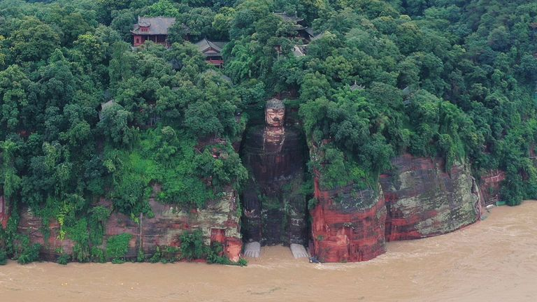 Floodwater reaches the Leshan Giant Buddha's feet following heavy rainfall, in Leshan, Sichuan province, China August 18, 2020. Picture taken August 18, 2020. China Daily via REUTERS ATTENTION EDITORS - THIS IMAGE WAS PROVIDED BY A THIRD PARTY. CHINA OUT.