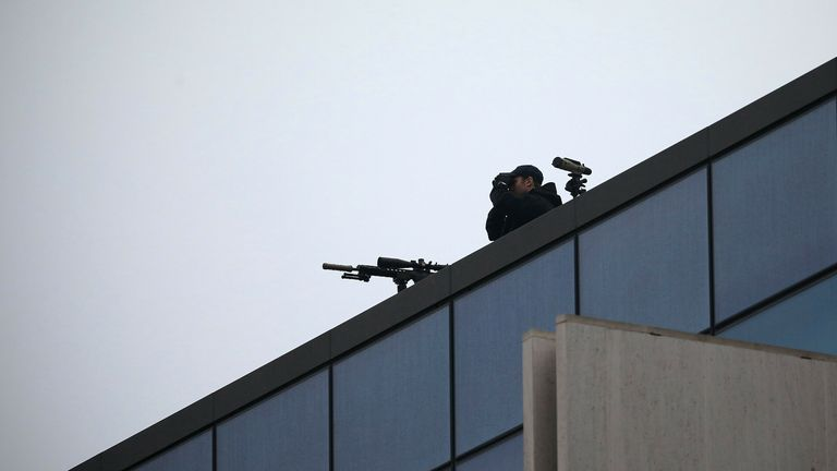 A police sniper monitors the surroundings from roof of the Christchurch High Court building ahead the first day of the four-day of the Australian white supremacist Brenton Tarrant's sentencing hearing in Christchurch