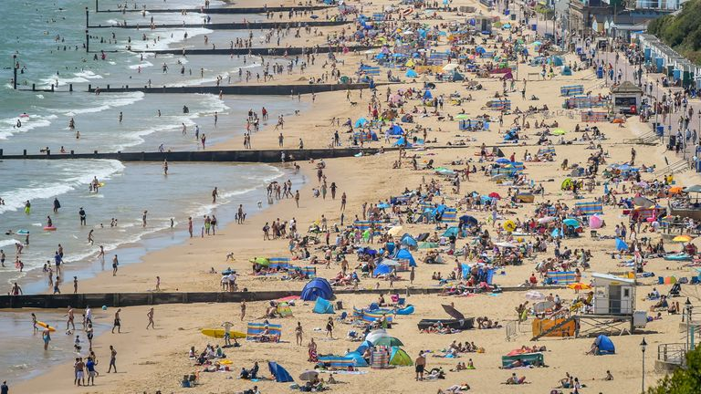 People enjoy the hot weather on the beach at Bournemouth on Saturday.
