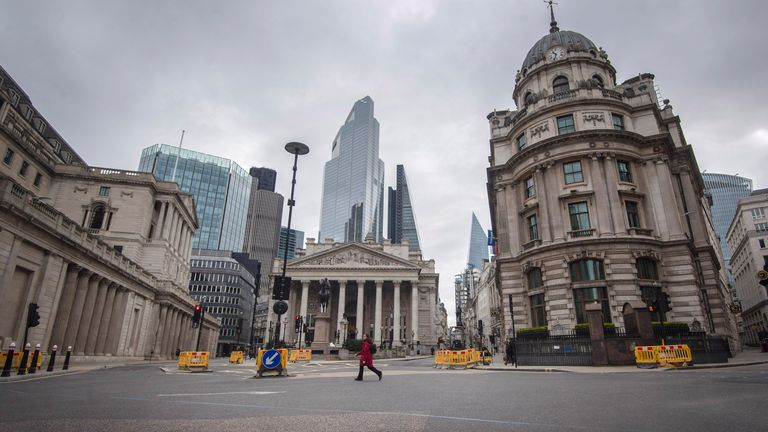 A woman walks through a deserted Bank junction in the City of London as the UK continues in lockdown to help curb the spread of the coronavirus 30/3/20