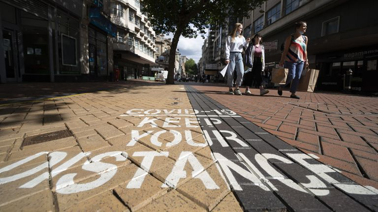 A COVID-19 warning sign in the city centre of Birmingham. Pic: Xinhua/Shutterstock
