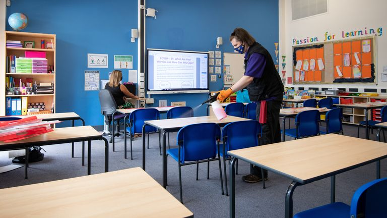 Joshua Lee disinfects tables at Queen's Hill Primary School in Costessey near Norwich, as they prepare to reopen. Read less Picture by: Joe Giddens/PA Wire/PA Images Date taken: 24-Aug-2020