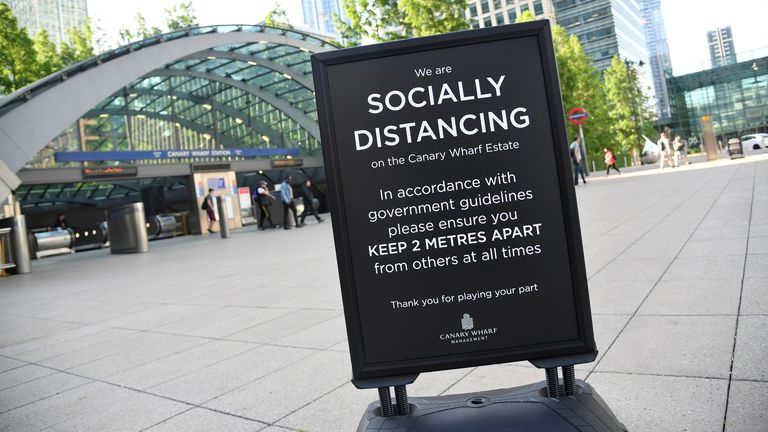 FILE PHOTO: A social distancing sign is pictured during morning rush hour in Canary Wharf, following the outbreak of the coronavirus disease (COVID-19), London, Britain, June 1, 2020. REUTERS/Toby Melville/File Photo