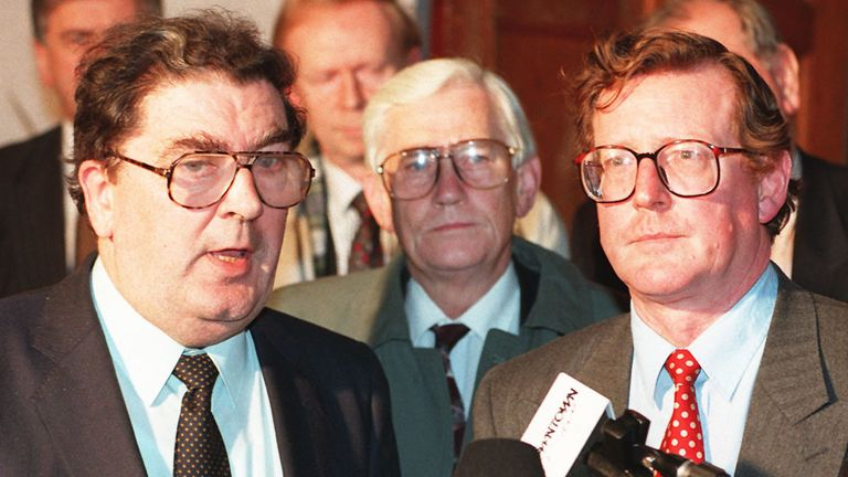 John Hume, leader of the SDLP, talks to journalists on the steps of the County Antrim Hotel, near Belfast, this evening (Monday) as Ulster Unionist leader David Trimble (right) looks on. Following their meeting, the leaders agreed to seek talks with Prime Minister John Major on the future of Northern Ireland's economy. Photo by Brian Thompson/PA. SEE PA STORY ULSTER Politics.
