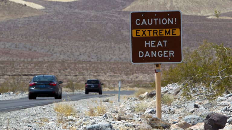 A sign warns of extreme heat at Death Valley National Park in California
