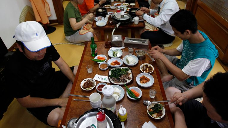 People eat dog meat at a restaurant in South Korea