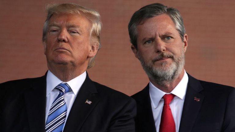 US President Donald Trump (L) and Jerry Falwell (R), on stage at Liberty University in May 2017