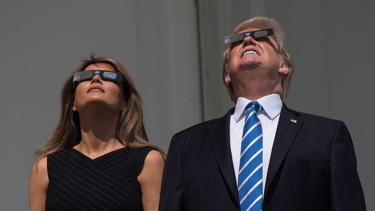 Donald Trump, seen looking at a partial solar eclipse back in 2017, hopes to be re-elected in November