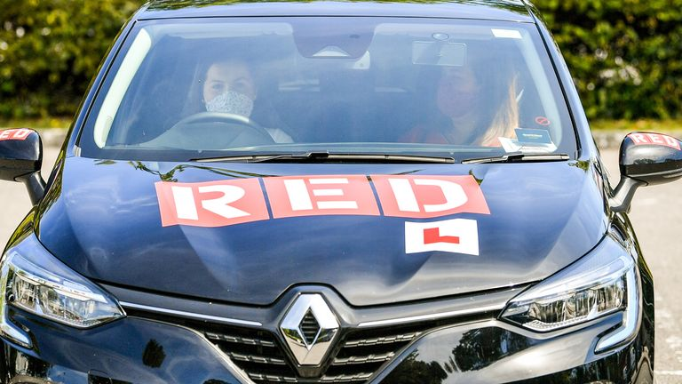 Student driver Roisin Clarke, 17, (L) passed her test when they first resumed in July