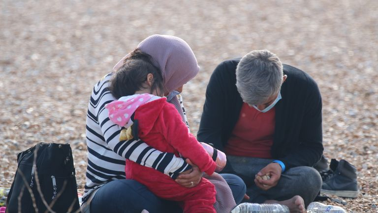 A woman hugs a child migrant after arriving in Dungeness earlier. Pic: Susan Pilcher