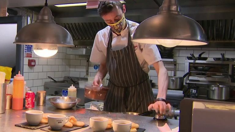 Will Eat Out to Help Out save jobs? Restaurant cook makes food.