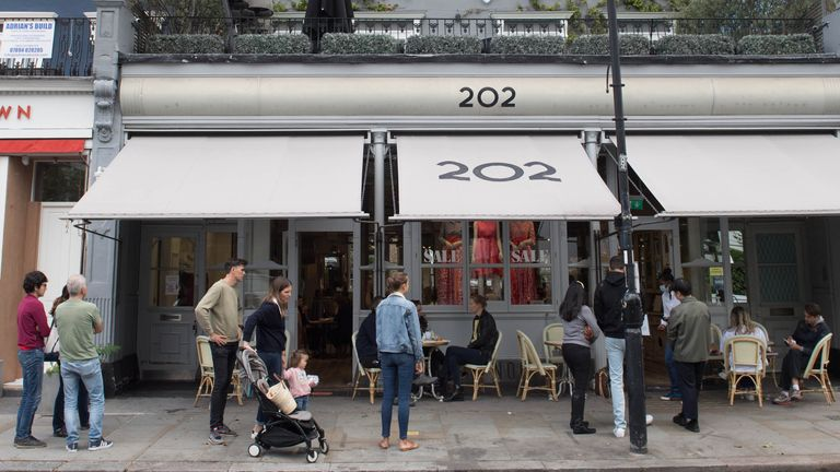 People queue at a restaurant in Notting Hill on the last day of the Eat Out to Help Out initiative