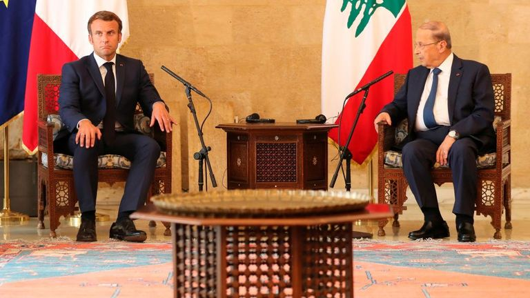 Mr Macron met with Lebanese president Michel Aoun, right, on Thursday