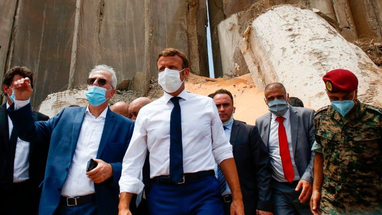 Emmanuel Macron, centre, visited the site of the blast on Thursday