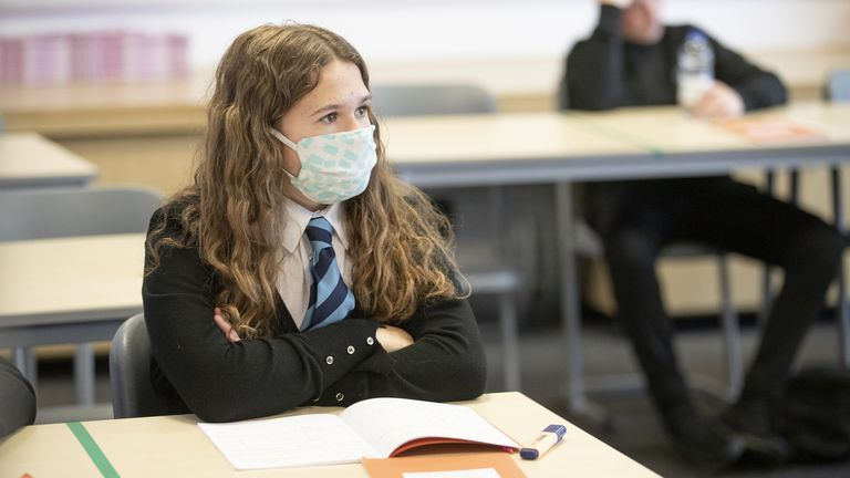 A student in Gourock, wears a face mask as new safety rules for secondary school pupils in Scotland came into force