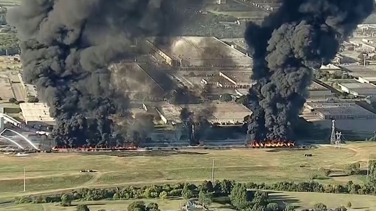 Massive double plume rises to the sky in Texas warehouse fire