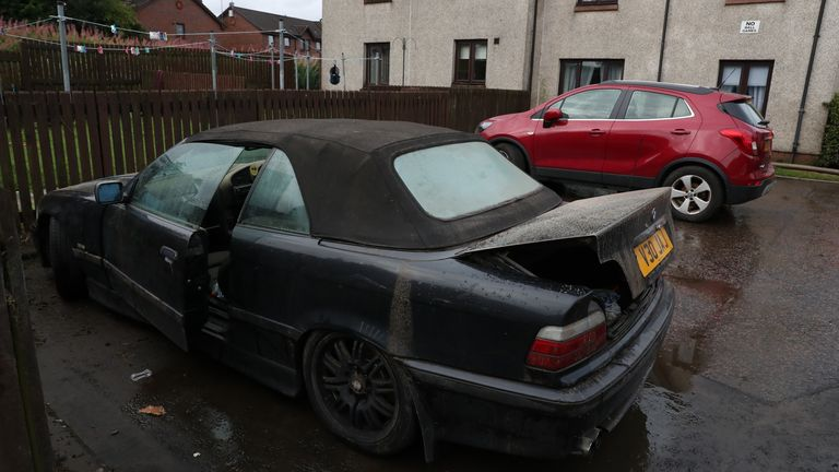 A water damaged car after flooding in Broxburn, West Lothian
