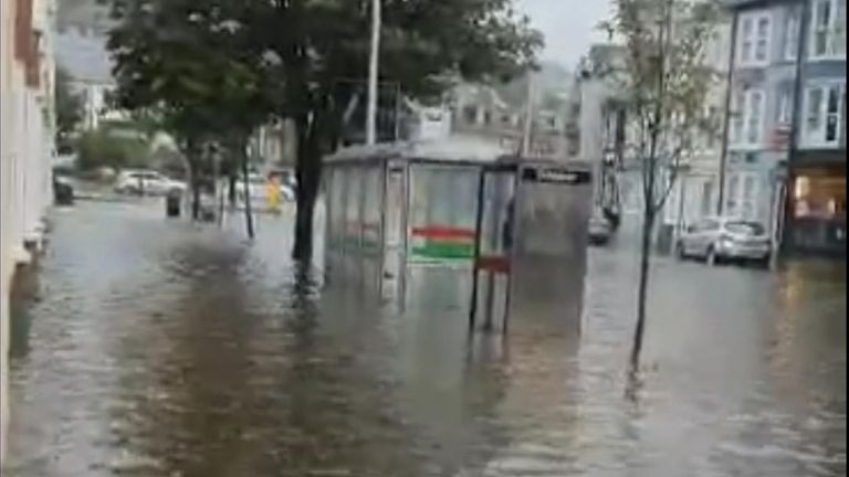 Aberystwyth has been hit by flash flooding after the UK heatwave