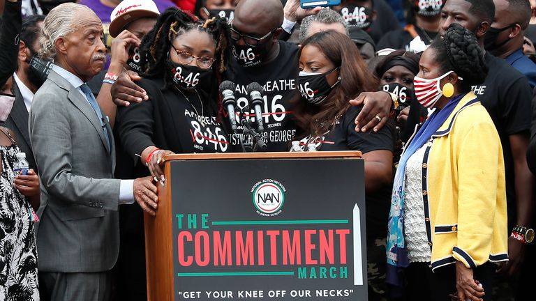 """Rev. Al Sharpton (L), Bridgett Floyd (2nd L) and Philonise Floyd (C), siblings of George Floyd, and Rep. Sheila Jackson Lee (R) stand at the podium at the 2020 March on Washington, officially known as the """"Commitment March: Get Your Knee Off Our Necks,"""" at the Lincoln Memorial on August 28, 2020 in Washington, DC."""