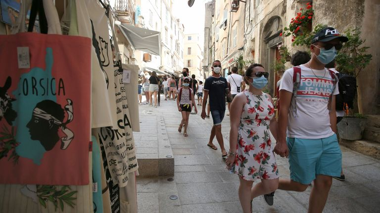 Tourists wear masks in the streets of Bonifacio, Corsica