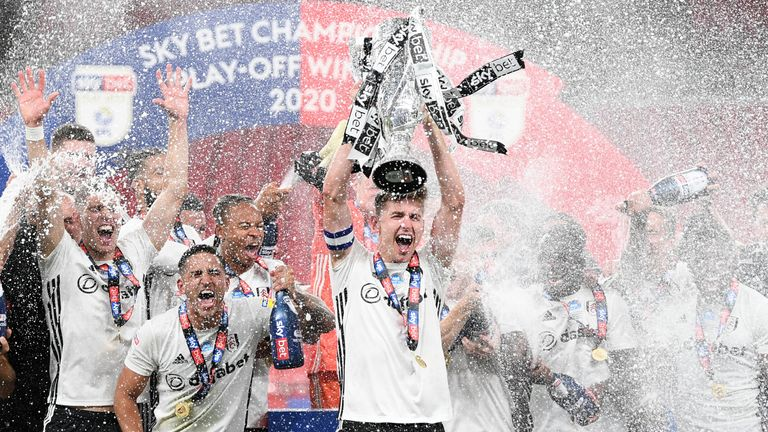 Jubilant Fulham players celebrate promotion to the Premier League