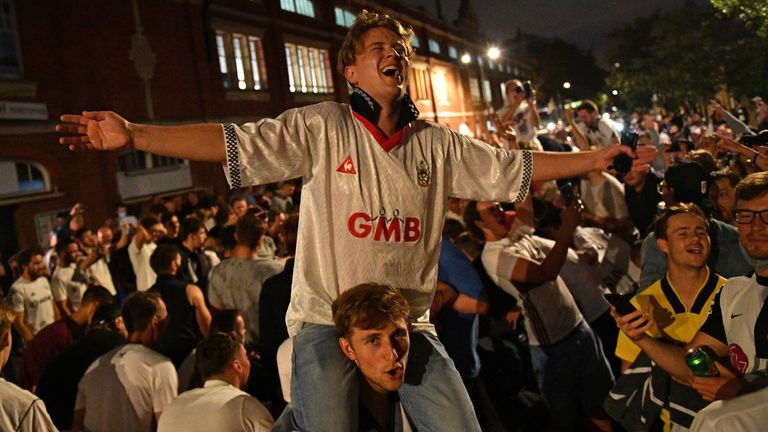 Fulham fans celebrate outside the team's Craven Cottage ground