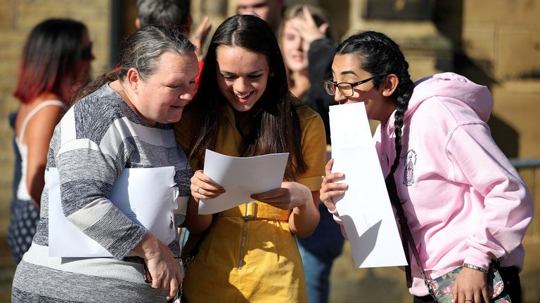 Students react as they check their GCSE results at Crossley Heath Grammar School, amid the spread of the coronavirus disease (COVID-19), in Halifax, Britain August 20, 2020. REUTERS/Molly Darlington